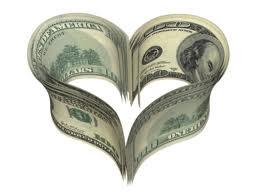 avaricia. Fotografía en la que aparecen varios billetes de dólar. No se puede saber cuántos (no muchos). Alguien ha tenido el ingenio de dividirlos en dos grupos para formar con ellos la imagen de un corazón.