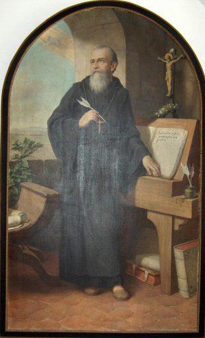 Cuadro que representa a san Benito de pie y con una pluma en la mano como interrumpido en su tarea de escribir