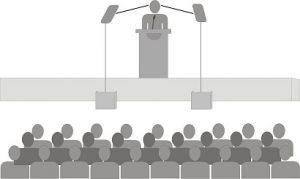 Conferencia. Dibujo en el que aparece un conferenciante ante su público